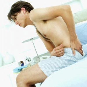 Man with Pelvic Pain in Doctor's Office